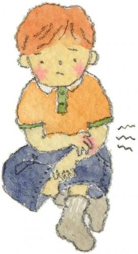 かゆいに不快感を示す少年のイラスト